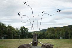 Monument at the entrance of the village of Rondine, Arezzo. Each swallow has its own flight.