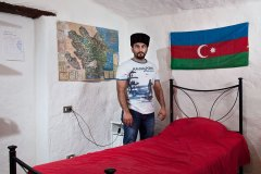 Orkhan, 25, from Azerbaijan in his room at Rondine. In Italy follows a master's degree inInternational Relations and Economics.